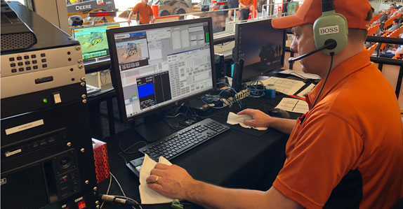 eClerk operator works the controls for online bidding at Ritchie Bros. auction in Orlando