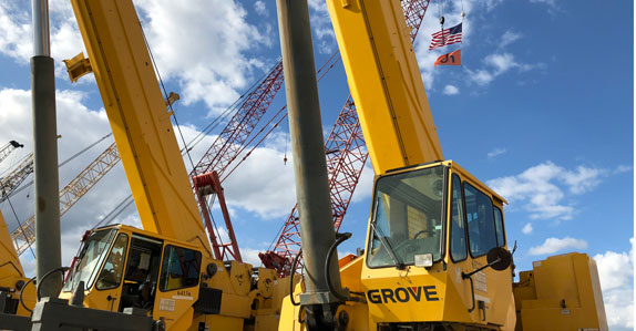 Cranes stand tall in the Ritchie Bros. auction yard in Orlando