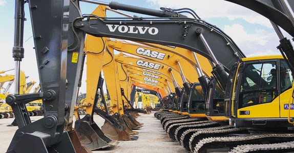 excavators in the Ritchie Bros. auction yard in Orlando
