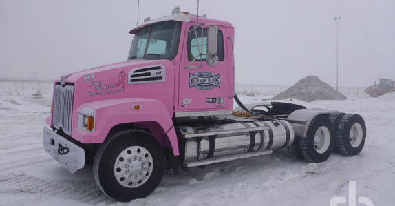 Pink gravel truck ready to sell in Ritchie Bros. Edmonton auction